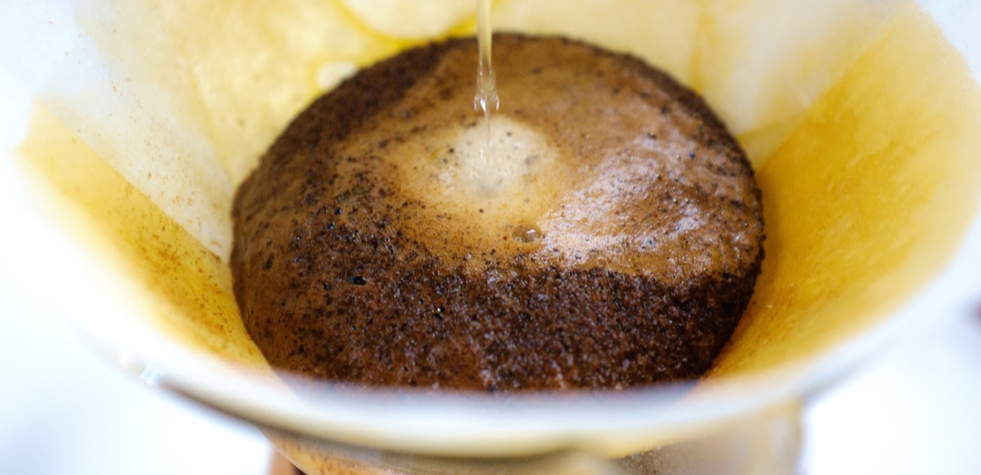 coffee grounds in a pour over. it's time to take out your stinky head trash