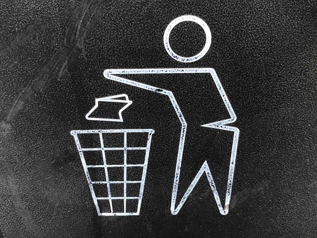 chalk drawing of someone throwing away their head trash